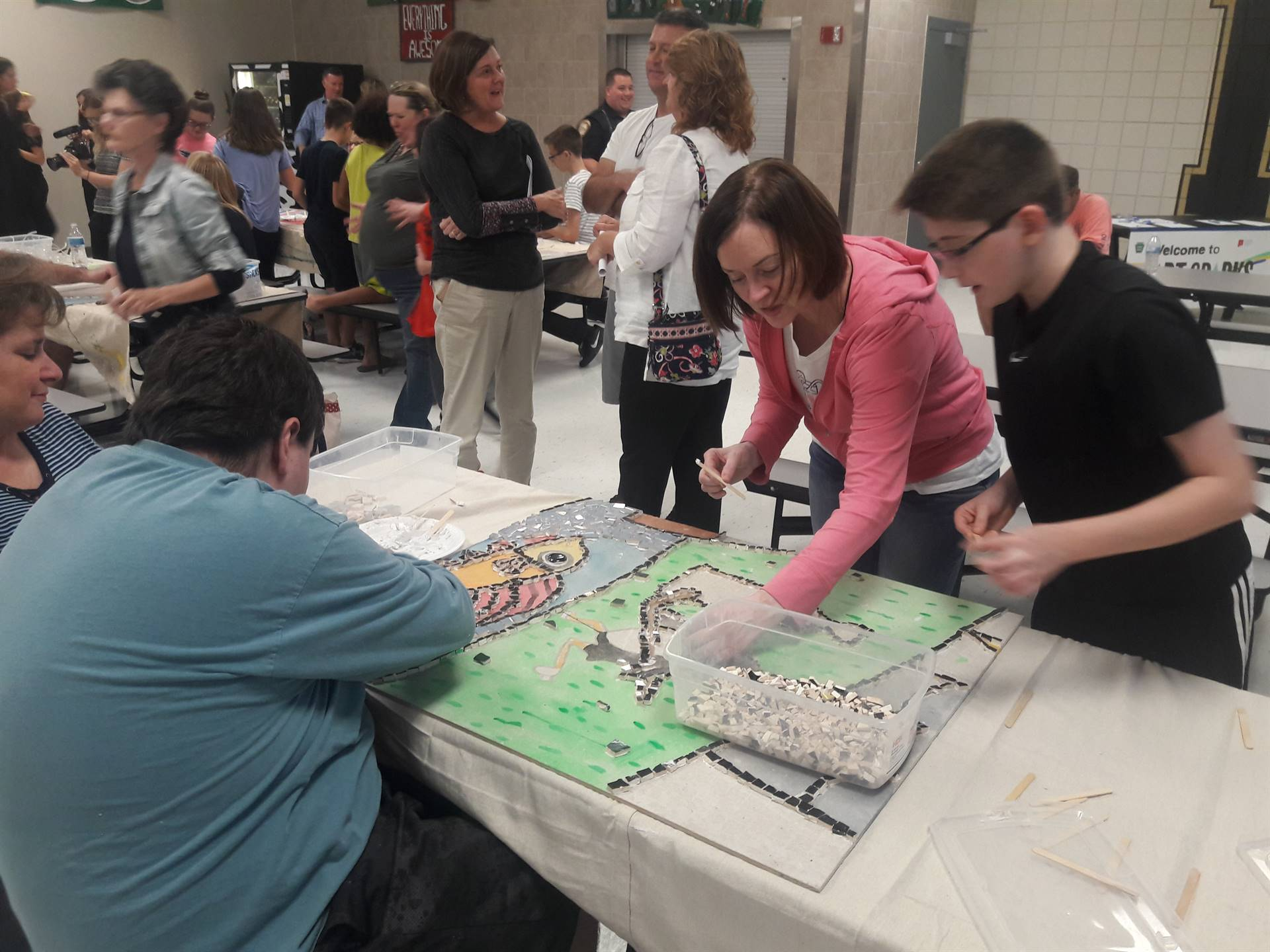 Community Event Night - students, family and community members fill in the Mosaic with colored tile
