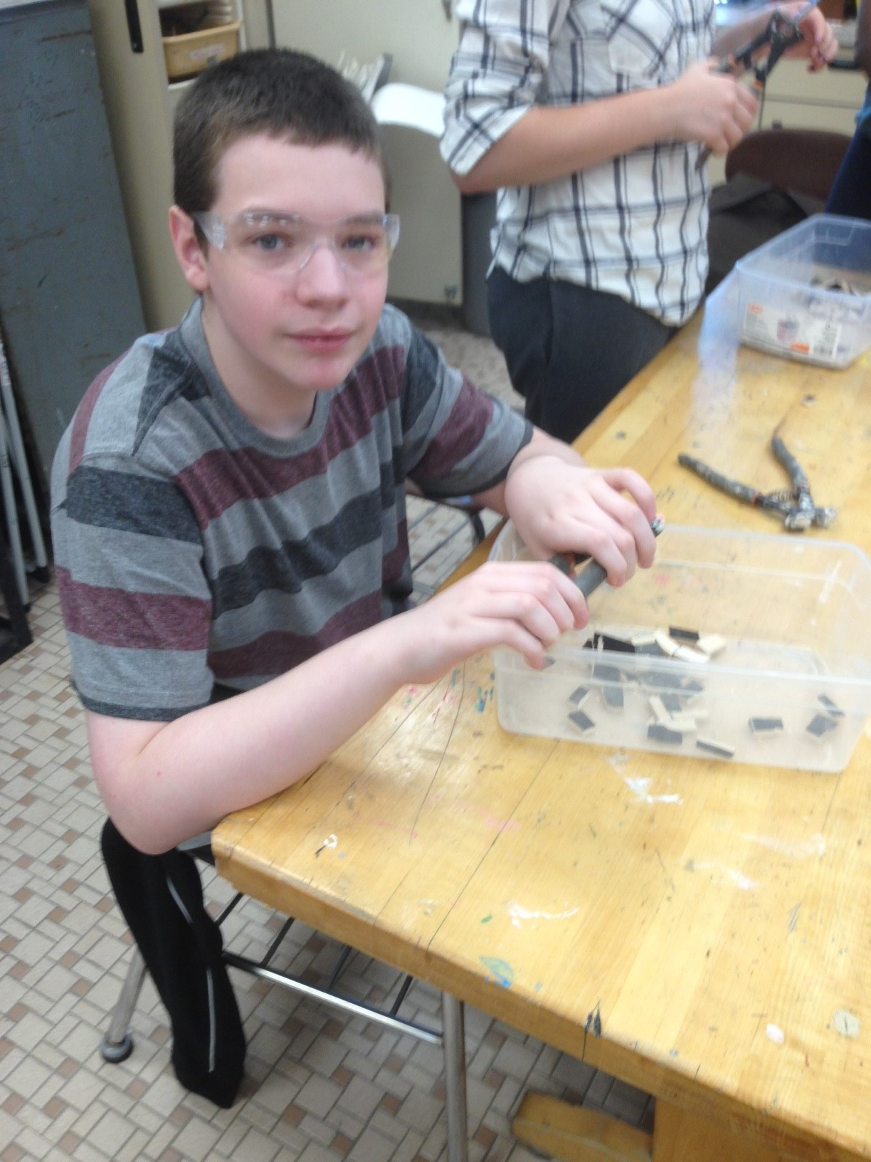 Students cut the tile in small rectangular pieces
